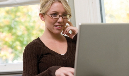 Blond lady on laptop