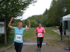 Julia and Becca crossing the finish line of the Chiltern Warrior 10k